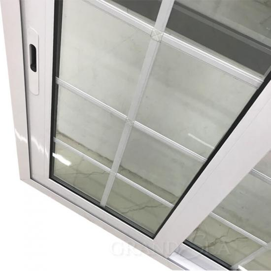 white color aluminum frame window with grill design